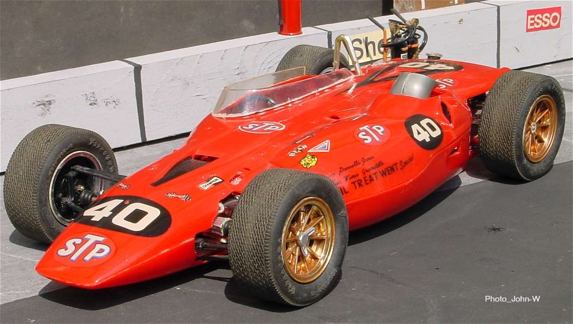 The side engine racer was driven by Parnelli Jones :,stp granatelli